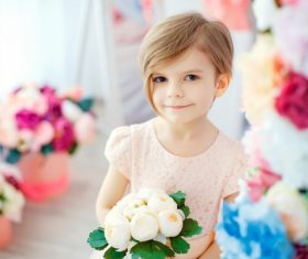 Little girl holding white bouquet Stock Photo 01