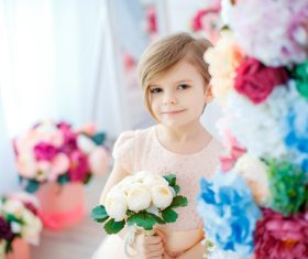 Little girl holding white bouquet Stock Photo 02