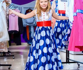 Little girl picking new clothes Stock Photo