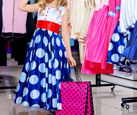 Little girl posing in children's clothing area Stock Photo 01