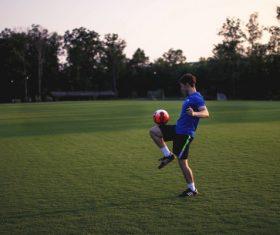Man Jolts the ball Stock Photo