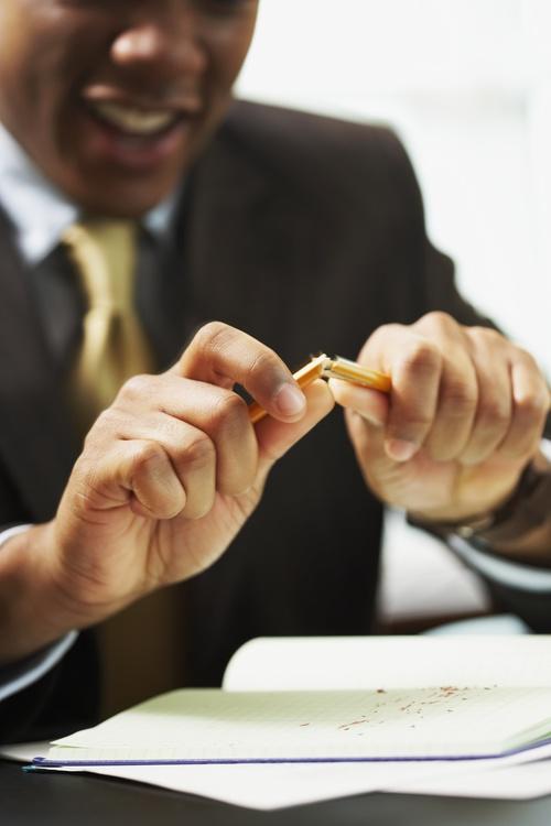 Man break off pencil Stock Photo