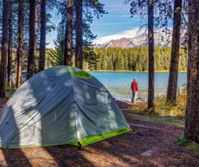 Man camping at the lake Stock Photo