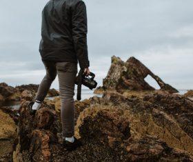 Man enjoying sea scenery with camera Stock Photo