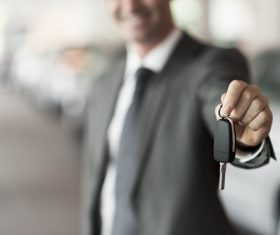 Man holding car key in hand Stock Photo