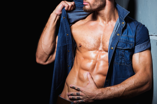 Man in denim uniform showing bare muscles Stock Photo 01