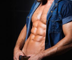 Man in denim uniform showing bare muscles Stock Photo 02