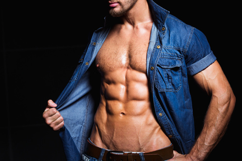 Man in denim uniform showing bare muscles Stock Photo 03