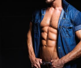 Man in denim uniform showing bare muscles Stock Photo 04