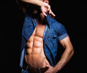 Man in denim uniform showing bare muscles Stock Photo 05