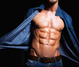 Man in denim uniform showing bare muscles Stock Photo 06
