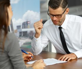 Man looking at contract Stock Photo
