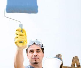 Man paint wall Stock Photo