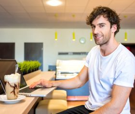 Man relaxing at home and surfing the internet Stock Photo