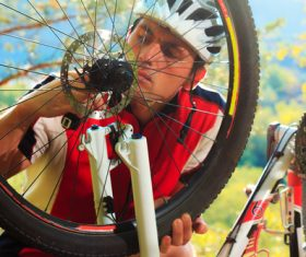 Man repairing bicycle Stock Photo