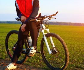 Man sitting resting on bicycle Stock Photo