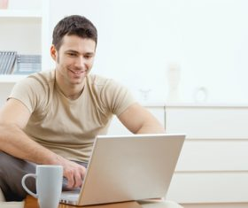 Man surfing the internet at home Stock Photo 01