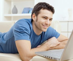 Man surfing the internet at home Stock Photo 02