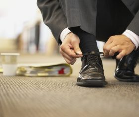 Man tying his shoelace Stock Photo