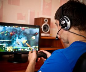 Man uses game handle to play games Stock Photo 01