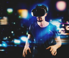 Man wearing VR virtual glasses Stock Photo