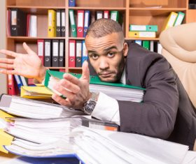 Man who cant finish work Stock Photo