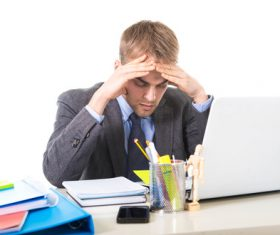 Man working exhaustedly in the office Stock Photo