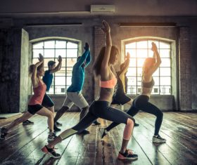 Men and women doing aerobics Stock Photo