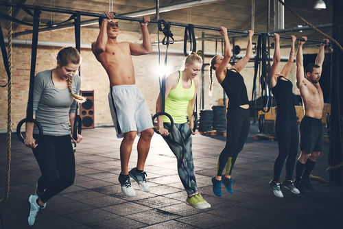 Men and women exercising in the gym Stock Photo