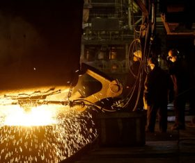 Metallurgy furnace and smelter metal factory workers Stock Photo
