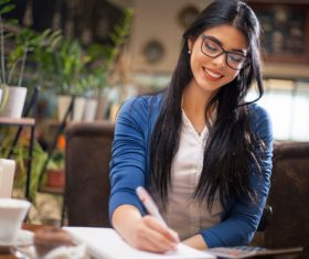 Modern businesswoman working at cafe Stock Photo 01