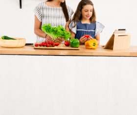 Mother and daughter watch video learn how to cook Stock Photo 03