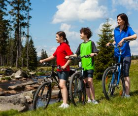 Mother with children riding bicycle outing Stock Photo 01