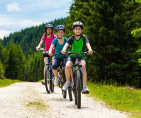 Mother with children riding bicycle outing Stock Photo 02