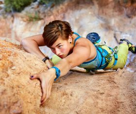 Outdoor woman unarmed rock climbing Stock Photo 01