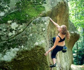 Outdoor woman unarmed rock climbing Stock Photo 03