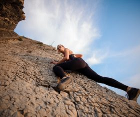 Outdoor woman unarmed rock climbing Stock Photo 04