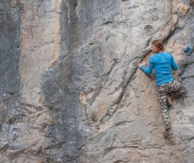 Outdoor woman unarmed rock climbing Stock Photo 05