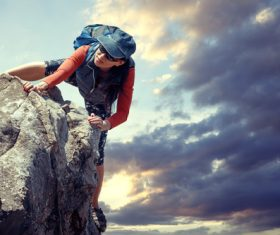 Outdoor woman unarmed rock climbing Stock Photo 06