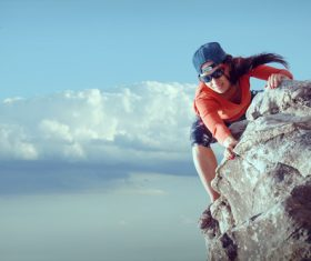 Outdoor woman unarmed rock climbing Stock Photo 07