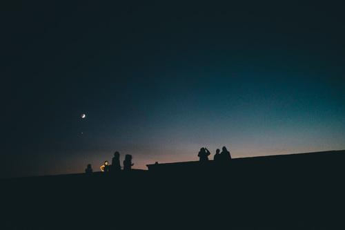 People watching moonlight in dark night Stock Photo