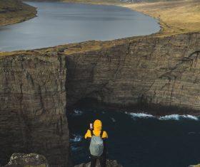 Person enjoying awesome mountain river scenery Stock Photo