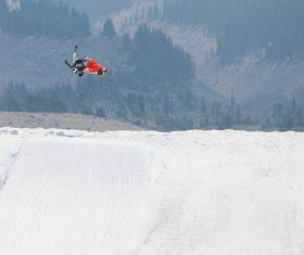 Person performing bicycle acrobat on mountain Stock Photo