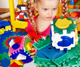Playing with building block little girl Stock Photo