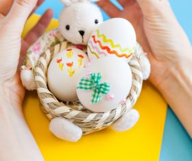 Rabbit basket and easter eggs Stock Photo