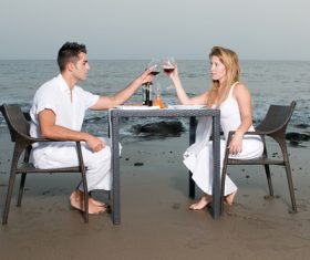 Romantic couple dining by the sea Stock Photo