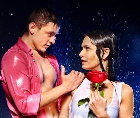 Romantic couple in the rain Stock Photo
