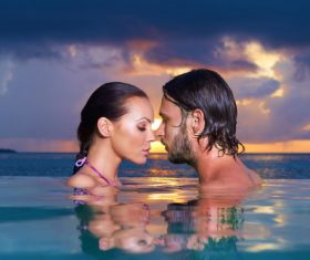 Romantic moments in the pool Stock Photo