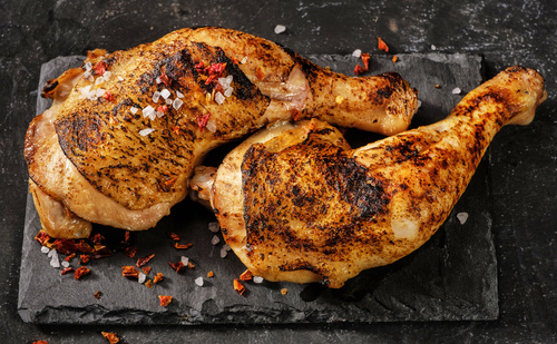 Salt pepper and roasted chicken legs Stock Photo