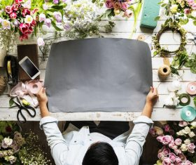 Shop assistant packing flowers Stock Photo